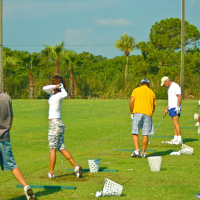 Golfer is praticing at Mangrove Bay Driving Range